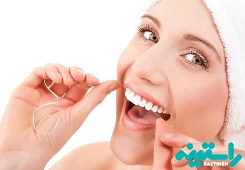 روش صحیح استفاده از نخ دندان